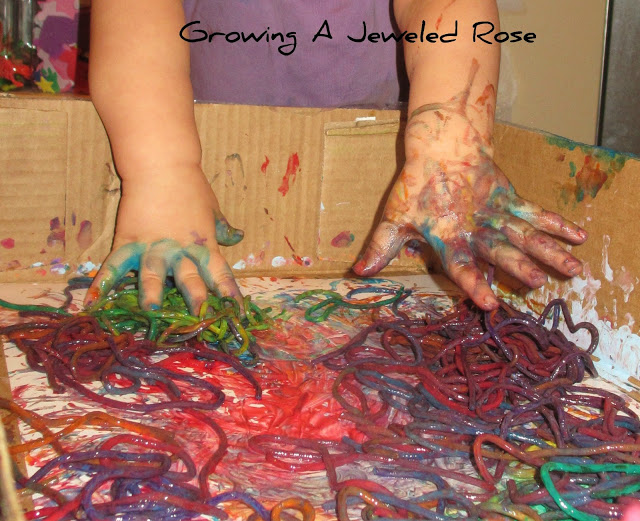 100 Things You Can Buy From the Dollar Tree and Use in Play - Perfect Nanny Match - spaghetti_painting_with_your_hands